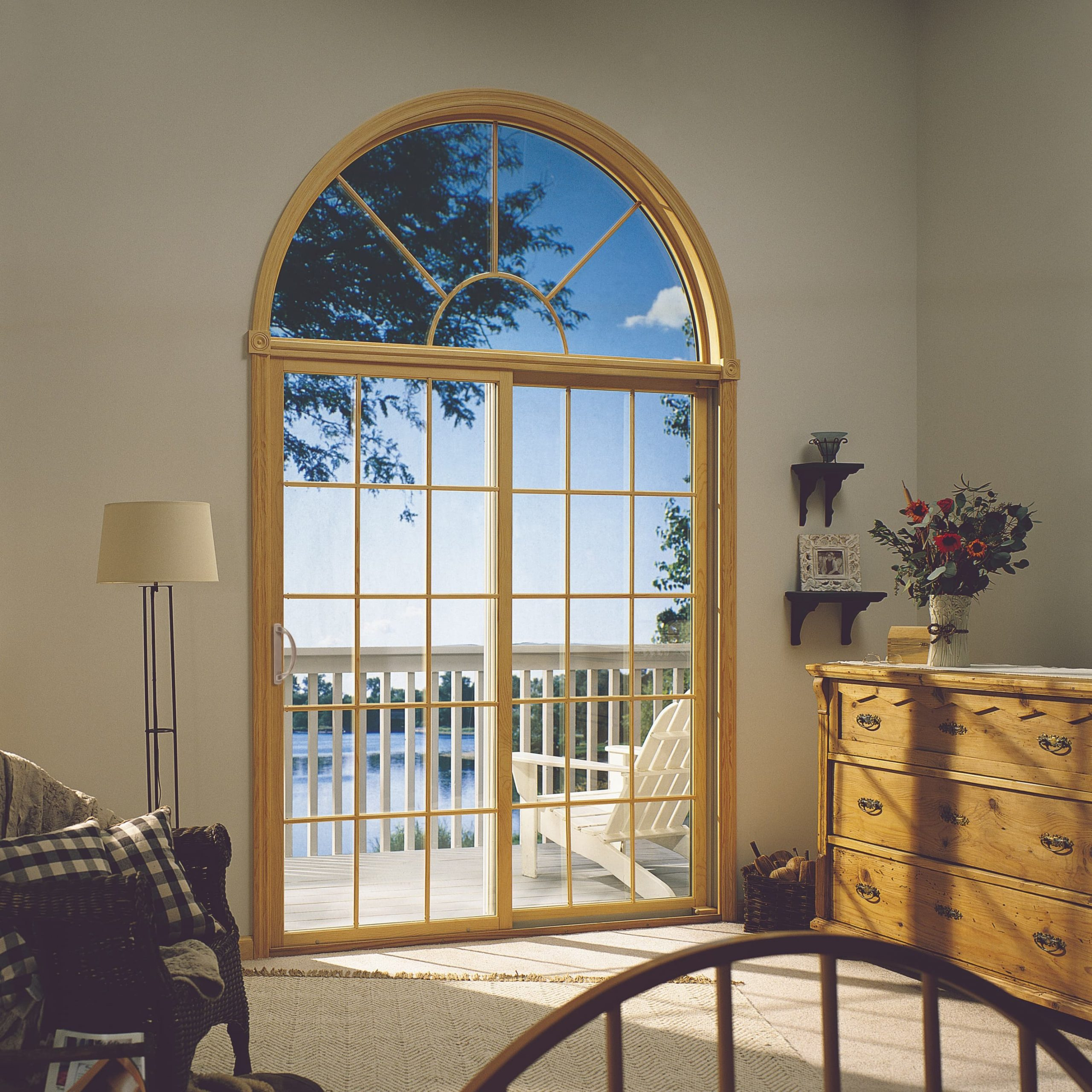 Interior photo of sliding patio doors with grids and arch