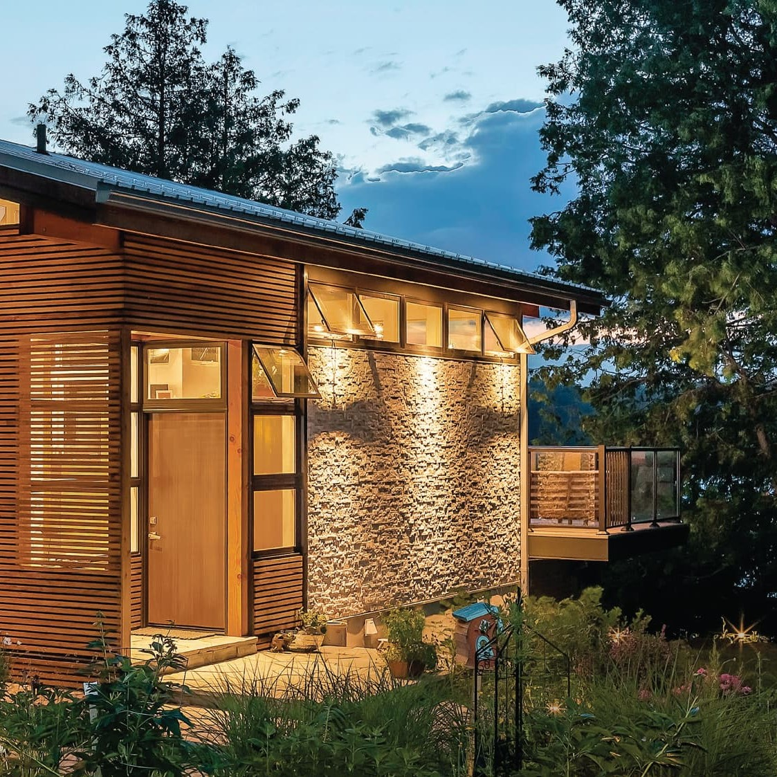 Exterior photo of awning windows on mountain cabin