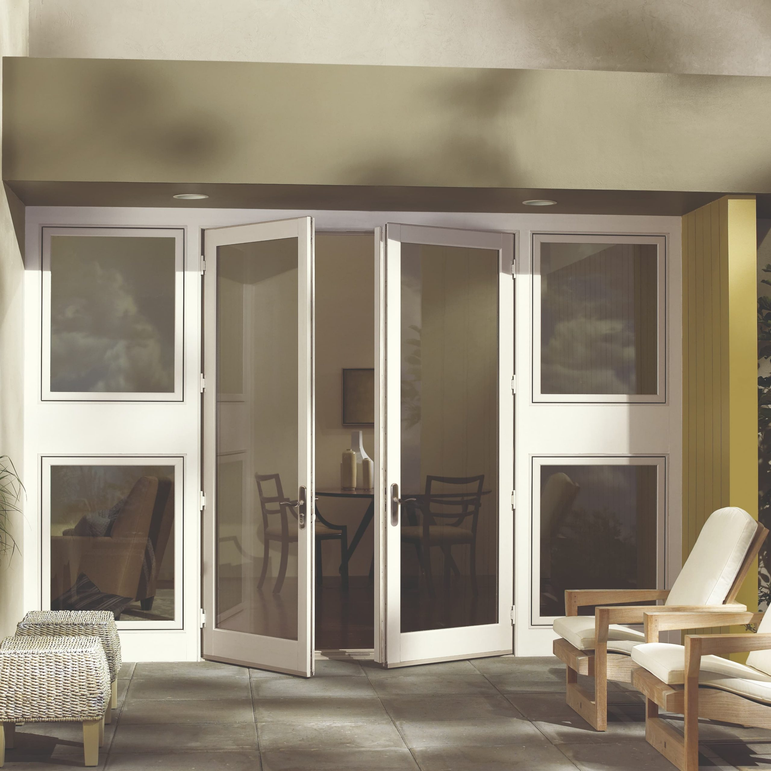 Swinging patio door in white