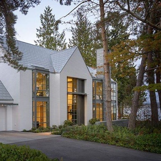 Arcadia thermal steel windows and doors in a traditional lakeside home